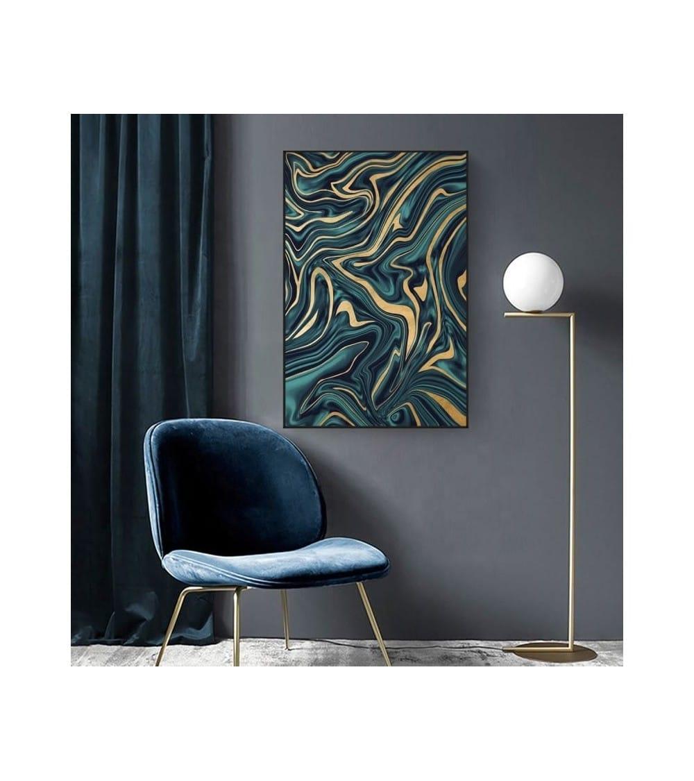 Tableau abstrait moderne couleur bleu et or cadre noir mis en ambiance avec une chaise scandinave