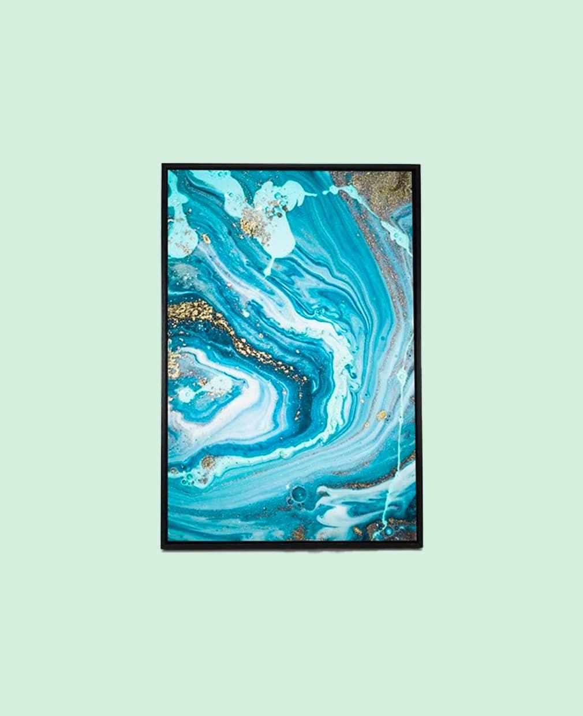 Tableau abstrait bleu clair avec un cadre noir charbon présenté de face